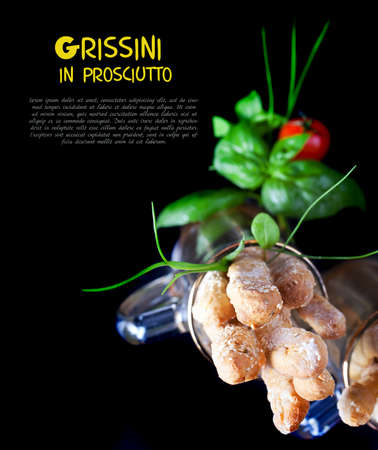 grissini: Grissini with prosciutto crudo and vegetables on black