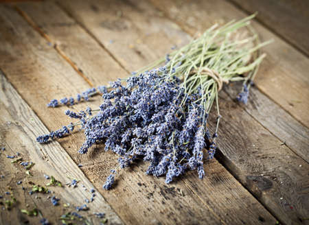 Bunch of lavender flowers on an old wood table Stock Photo