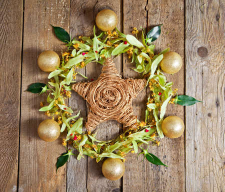linden blossom: Christmas composition with linden blossom on old wooden table Stock Photo