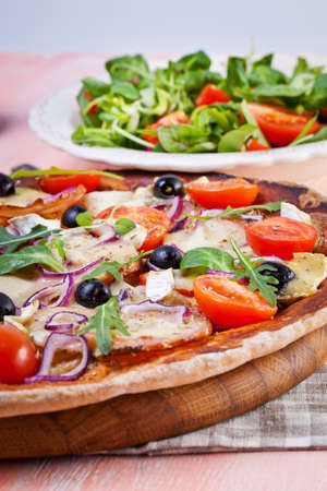 cured ham: Pizza with dry cured ham and salad
