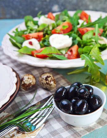 Caprese salad with tomatoes and mozzarella photo