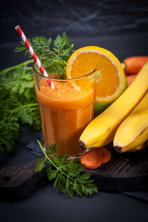 lifestile: Carrot orange smoothie. Healthy lifestile. Green concept.