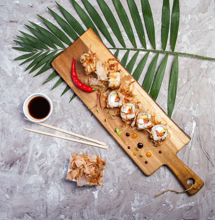 sake: Bonito Maki Sushi - Rolls with Fresh Salmon, Cucumber and Cream Cheese inside. Dried Shaved Bonito outside Foto de archivo