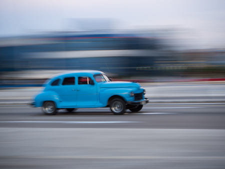 sensation: Havana, Cuba June 14, 2017. American classic blue car through the streets of Havana city in cuba with sensation of movement