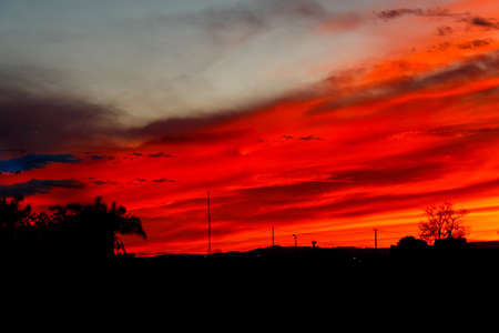 Photograph of a sunset with the sky colors extravagantly red