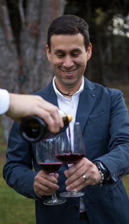Man with two glasses of wine before drinking them. Zdjęcie Seryjne