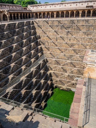 Immense well or cistern called Chand Baori made by slaves in the city of Jaipur in India.