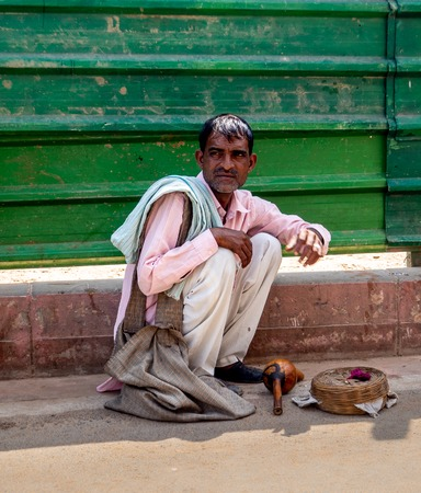 Jaipur, India, 18th to 22nd September 2018 Man on the street asking tourists for financial help
