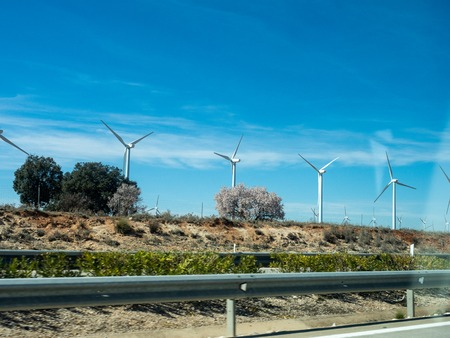 Pictures of wind energy mills from a car on the motorway