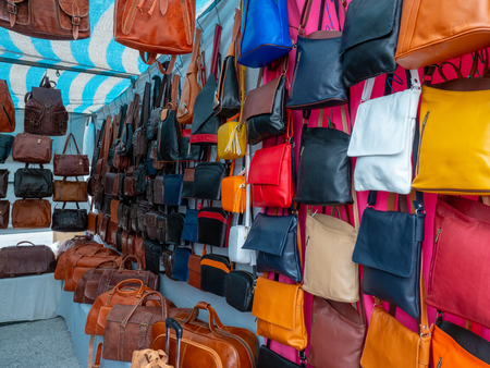 Image of some bags of various colours and types in a flea market