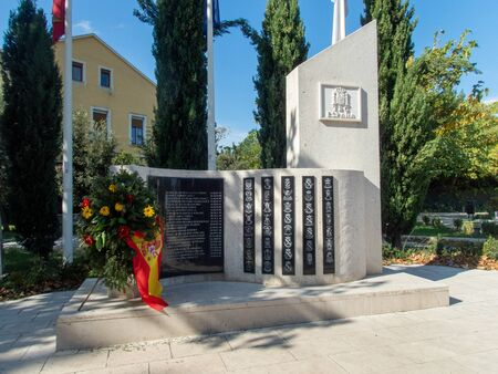 Stock photo of the monument to fallen Spanish soldiers of blue helmets with a Spanish flag and some flowers in Mostar, Herzegovina