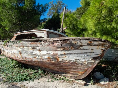 Stock photo of an abandoned boat on the beach in Cavtat, Croatia