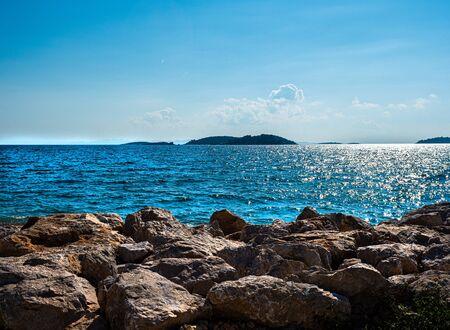 Stock photo of rocks crossing the line of the maritime coast in Cavtat, Croatia. Travel concept Reklamní fotografie