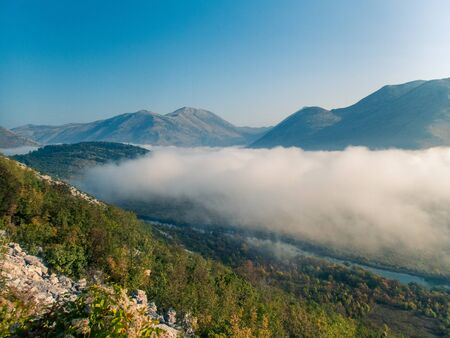 Stock photo of green mountains with fog in the middle of the valley. Croatia. Travel concept Reklamní fotografie
