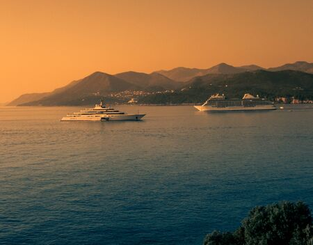 Stock photo of two cruise ships in front of the coastline in Dubrovnik, Croatia. Travel concept Reklamní fotografie