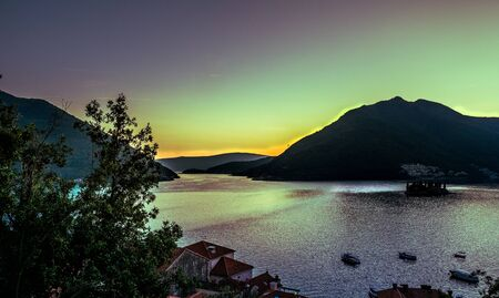 Stock photo of aerial view of Kotor bay as the sun sets, Montenegro. Travel concept