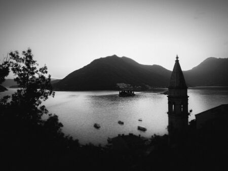 Stock black-and-white photo of the aerial view of Kotor Bay with the mosque minaret in the foreground. Travel concept Reklamní fotografie