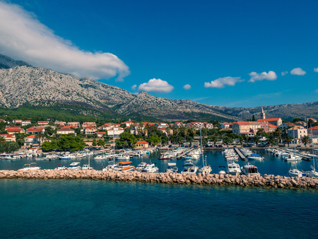 Stock photo of small seaport with the village in the background in Cavtat, Croatia. Travel concept