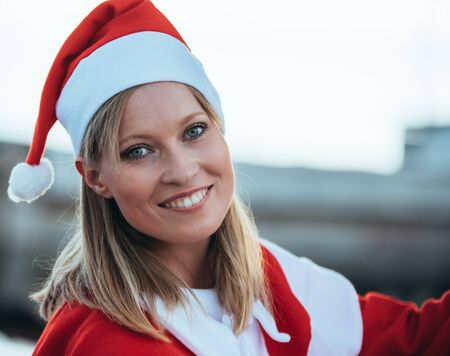 Stock photo of a close-up photo of causal girl and blonde dressed as mama noel. Christmas time Reklamní fotografie