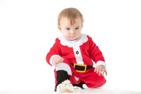 Stock studio photo with white background of a baby dressed like Santa. Portrait