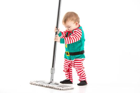 Stock studio photo with white background of a baby disguised as a elf with a mop Reklamní fotografie
