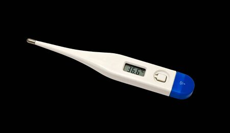 Digital body thermometer isolated on a black background photo