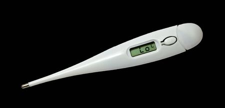 Digital thermometer isolated on a black background photo