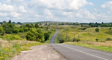 Hilly road. Summer scene photo