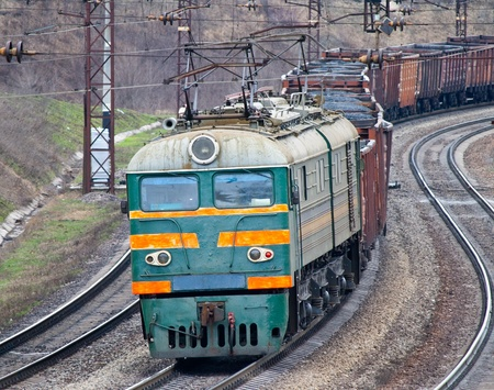 Heavy electric train pulled by electric locomitive Stock Photo - 12368245