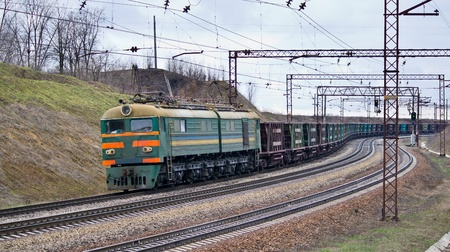 Train with iron ore pulled by electric locomotive Stock Photo - 12368247