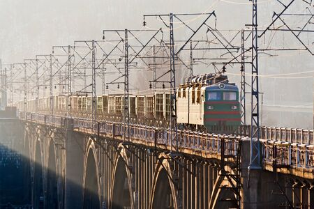 Freight train on a bridge over the Dnieper. Kyiv, Ukraine