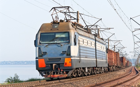Freight train on a bank of the Dnieper Stock Photo - 12368248