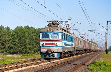 Passenger train hauled by electric locomotive Stock Photo - 12926074