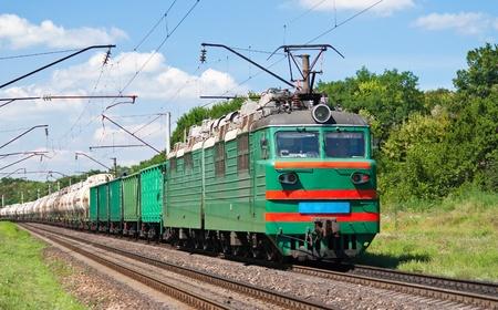 Electric locomotive pushing a cargo train in Ukraine Stock Photo - 13272466
