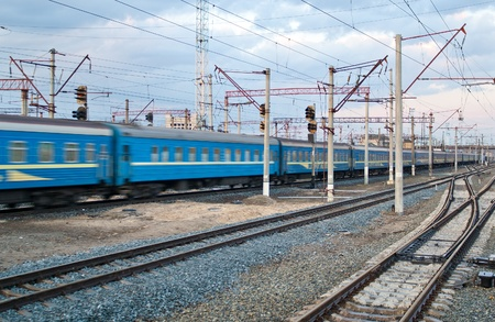 Passenger train passing the station Darnytsia, Kyiv, Ukraine Stock Photo - 13272463