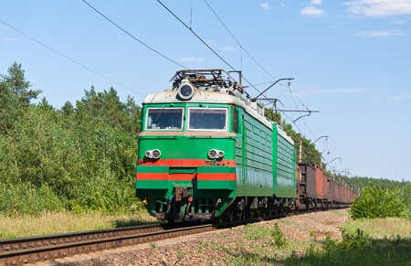 Freight train hauled by electric locomotive. Ukrainian railways photo
