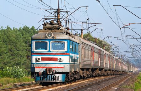 Passenger train hauled by electric locomotive. Ukraine railways Stock Photo - 13411822