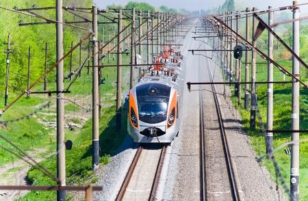 Modern fast passenger train in Ukraine photo