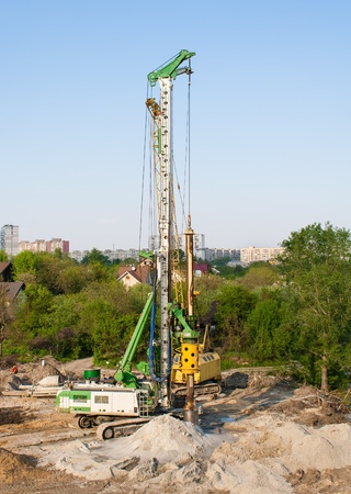 Pile driver at a construction site Stock Photo