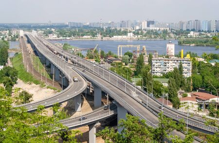 View of highway and railway bridges from a hill over the Dnieper river. Kyiv, Ukraine photo