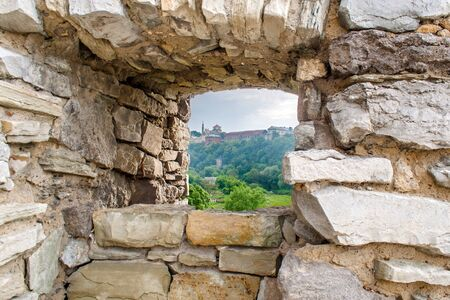 embrasure: View from the embrasure. Curtain wall at Kamyanets-Podilsky fortress, Ukraine Stock Photo
