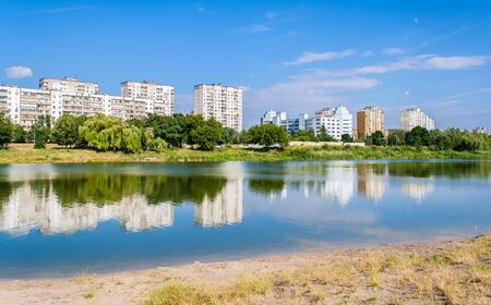 Residential buildings over a lake  Kyiv, Ukraine photo