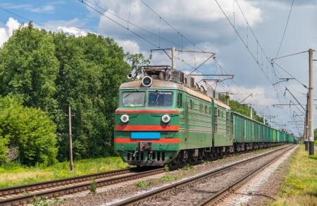 Freight train hauled by electric locomotive Ukrainian railways Stock Photo