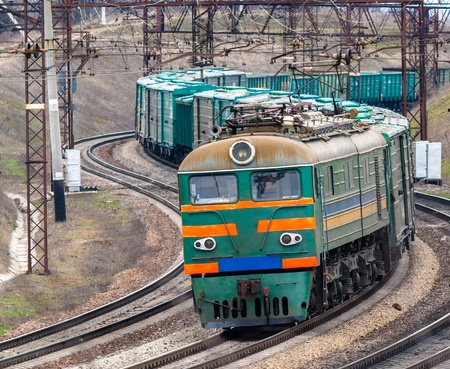 goods train: Heavy electric freight train in Ukraine Stock Photo