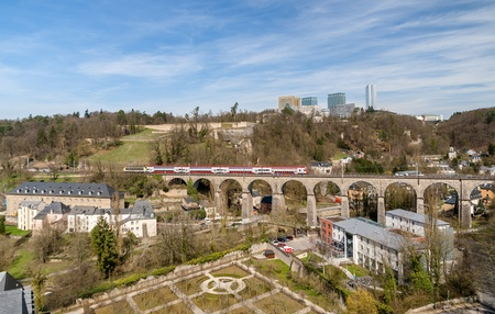 Train on viaduct in Luxembourg against background of European organisations buildings Stock Photo - 19133289