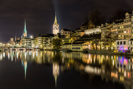 Zurich on banks of Limmat river at winter night photo