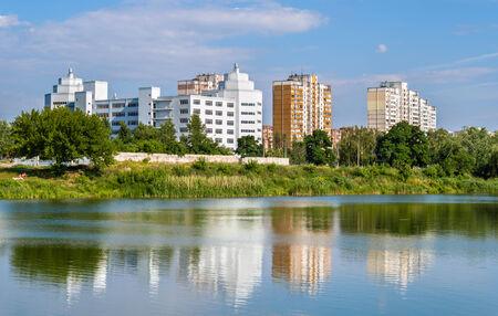 Residential buildings over a lake  Kyiv, Ukraine photo