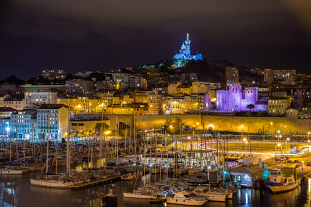 garde: Notre-Dame de la Garde over the Old Port in Marseille Stock Photo