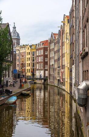 Canal in De Wallen district of Amsterdam photo