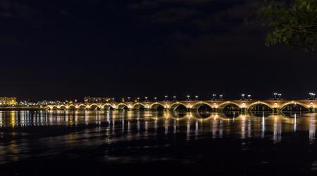 Night view of Pont de pierre in Bordeaux - Aquitaine, France photo
